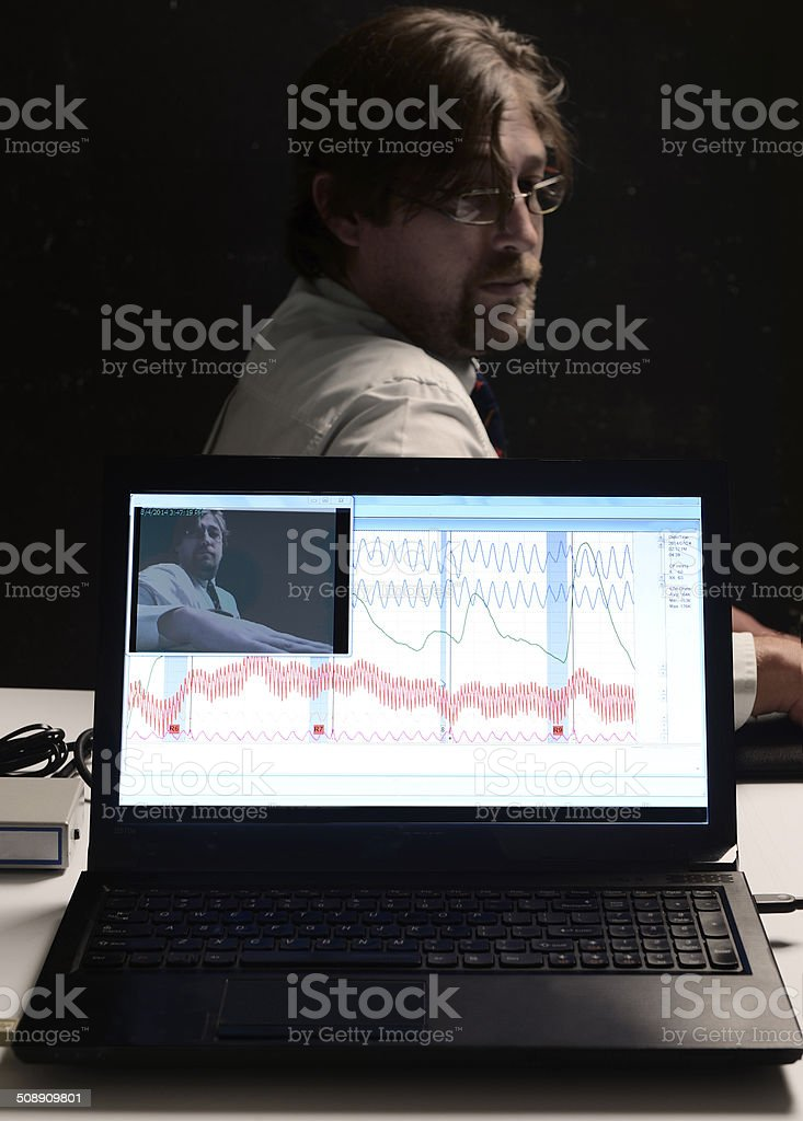 Screen view of worker undergoing polygraph testing stock photo