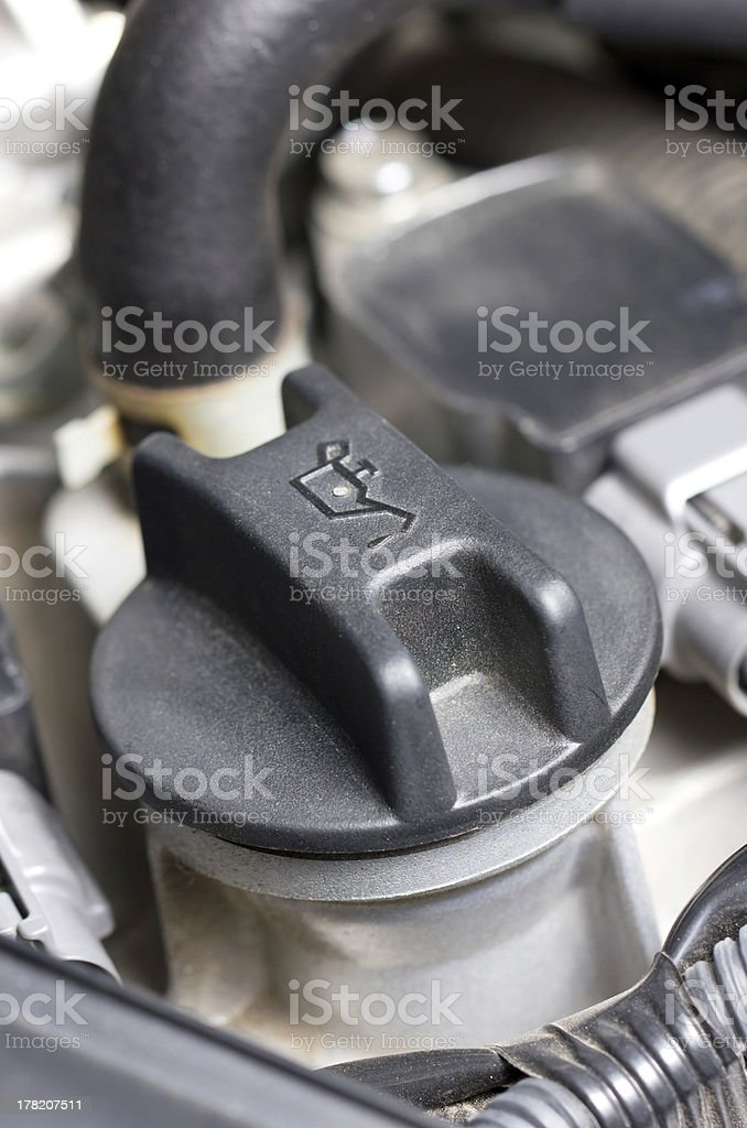 Screw cap of oil in engine. royalty-free stock photo