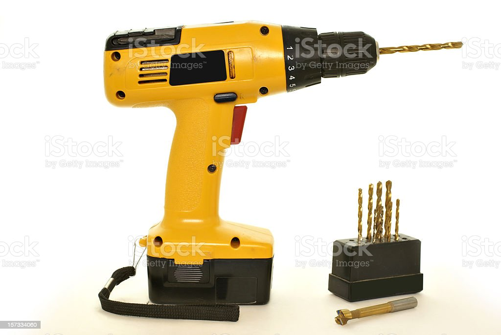 screw drill with bits on white background royalty-free stock photo