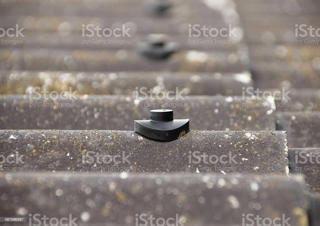 Screw protection stud on asbestos roof stock photo