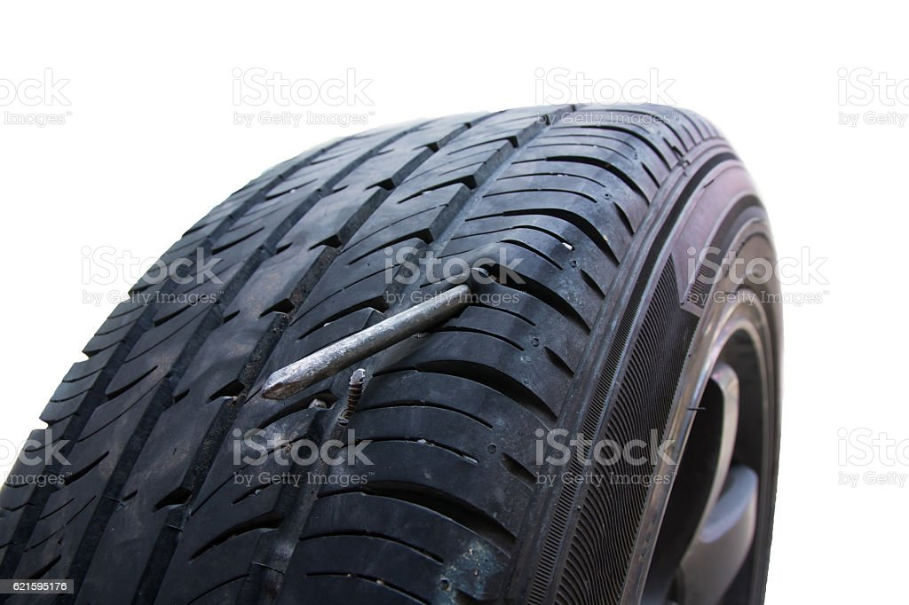 Screw Puncturing Tire, flat tire stock photo