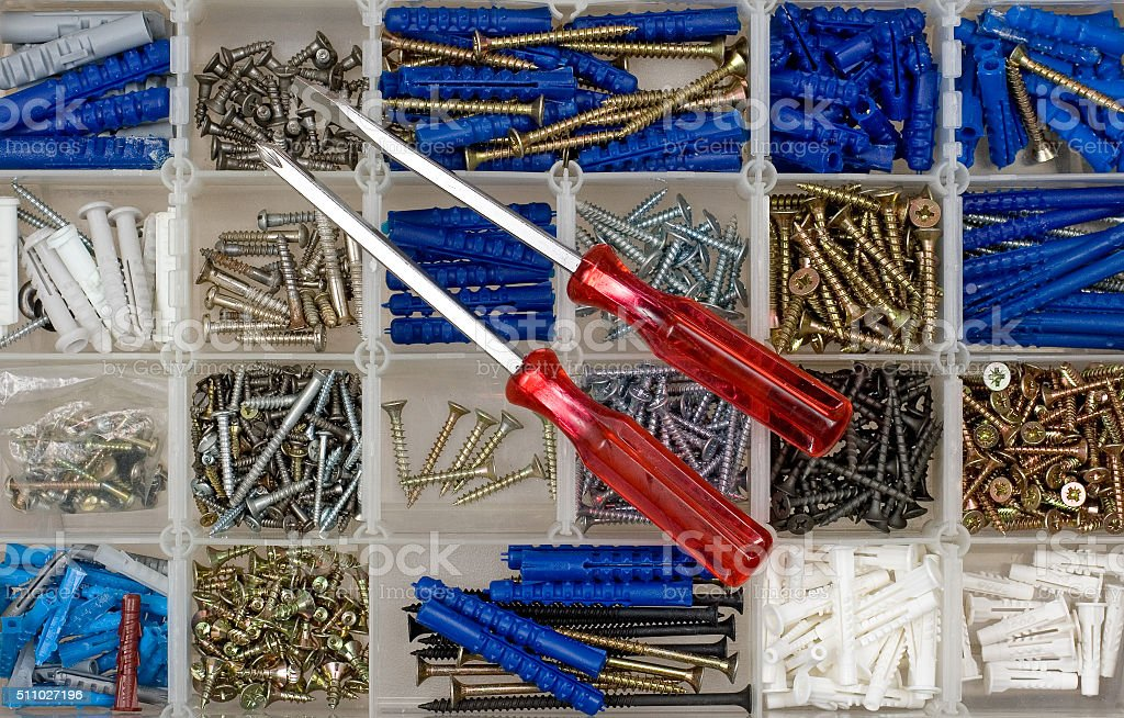 Screwdrivers, screws and dowels stock photo