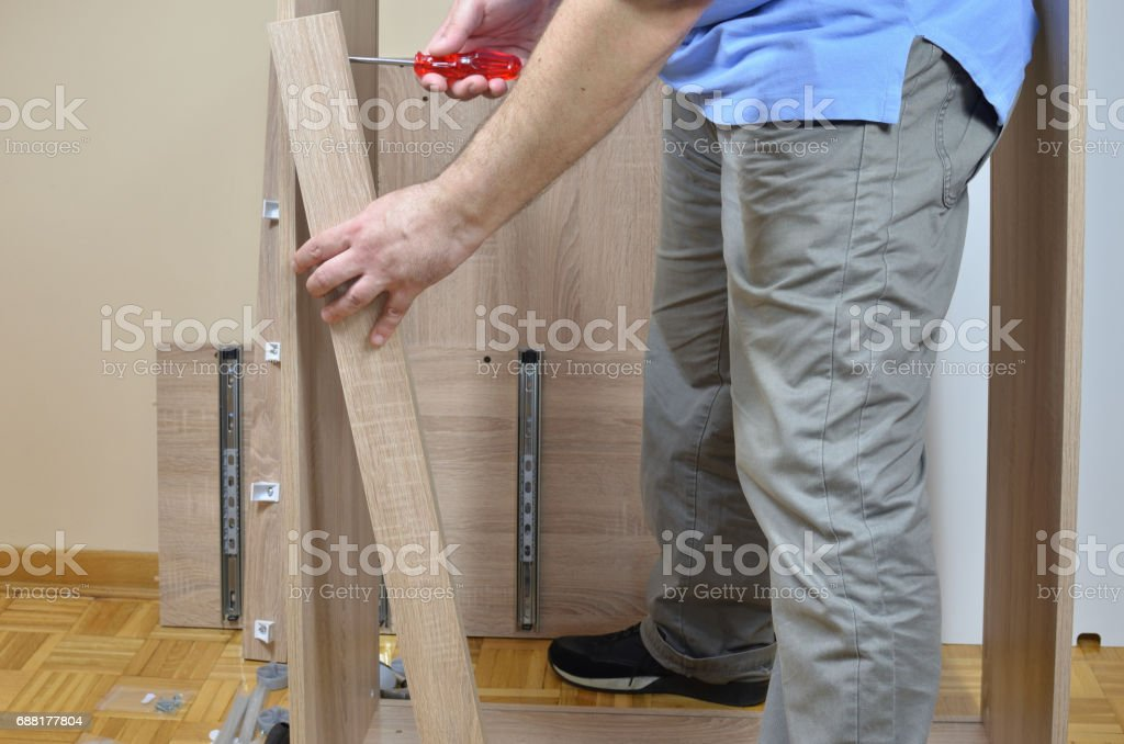 Screwing Elements of Furniture stock photo