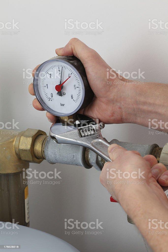 Screwing pressure gauge royalty-free stock photo