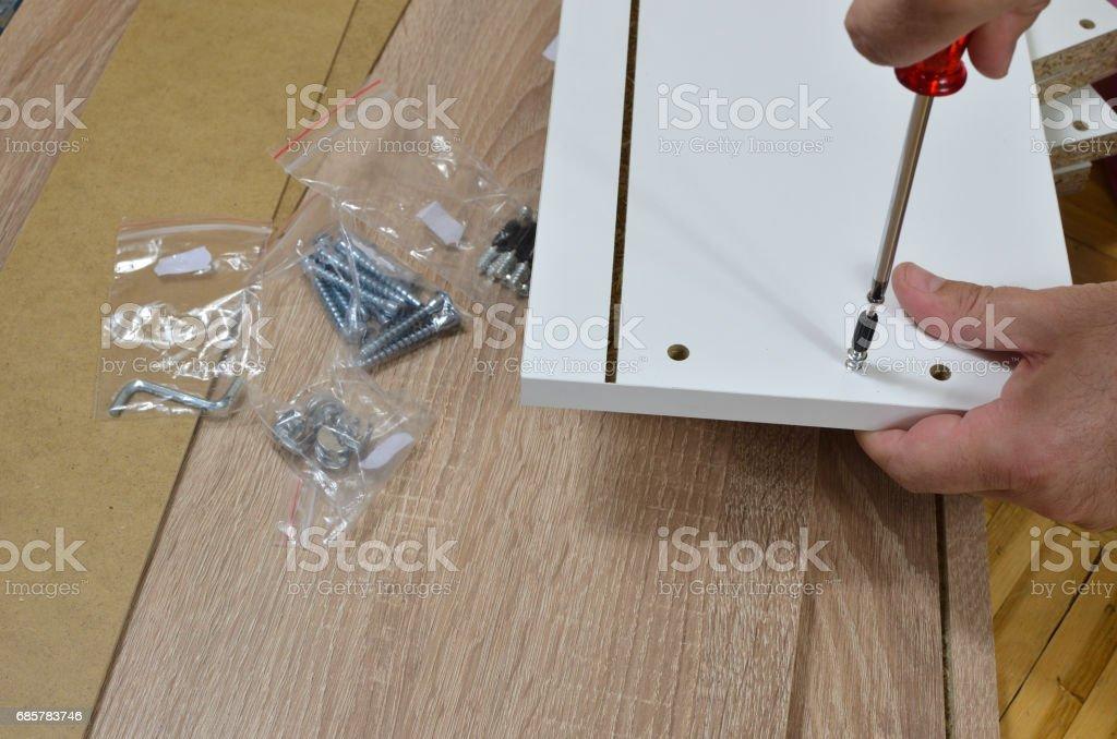 Screwing Wood Screw stock photo