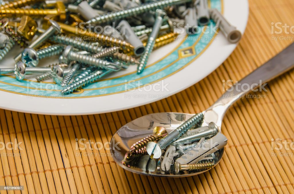 Screws and dowel spoon stock photo