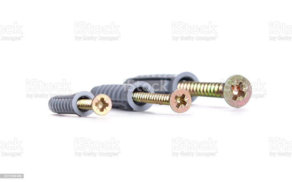 screws and dowels on a white background stock photo