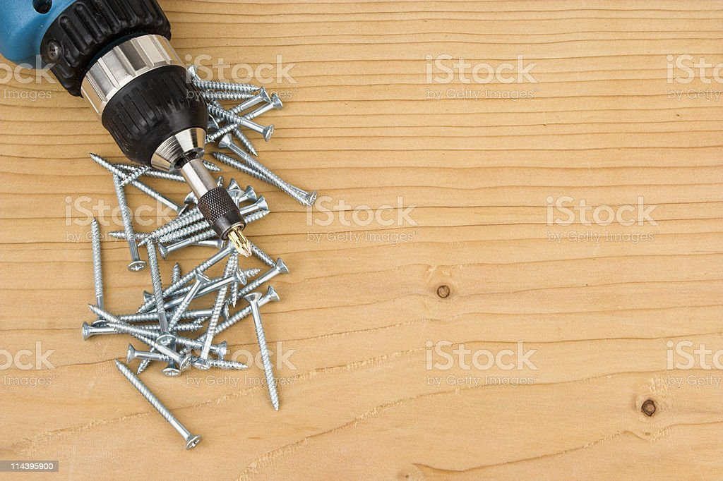 Screws And Drill Driver On Wood stock photo