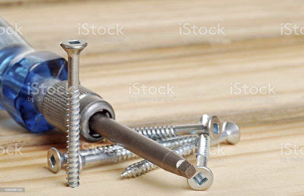 screws and screwdriver stock photo