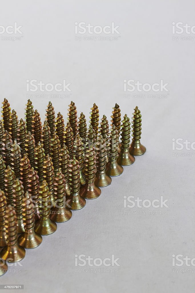 screws lined up around the corner royalty-free stock photo