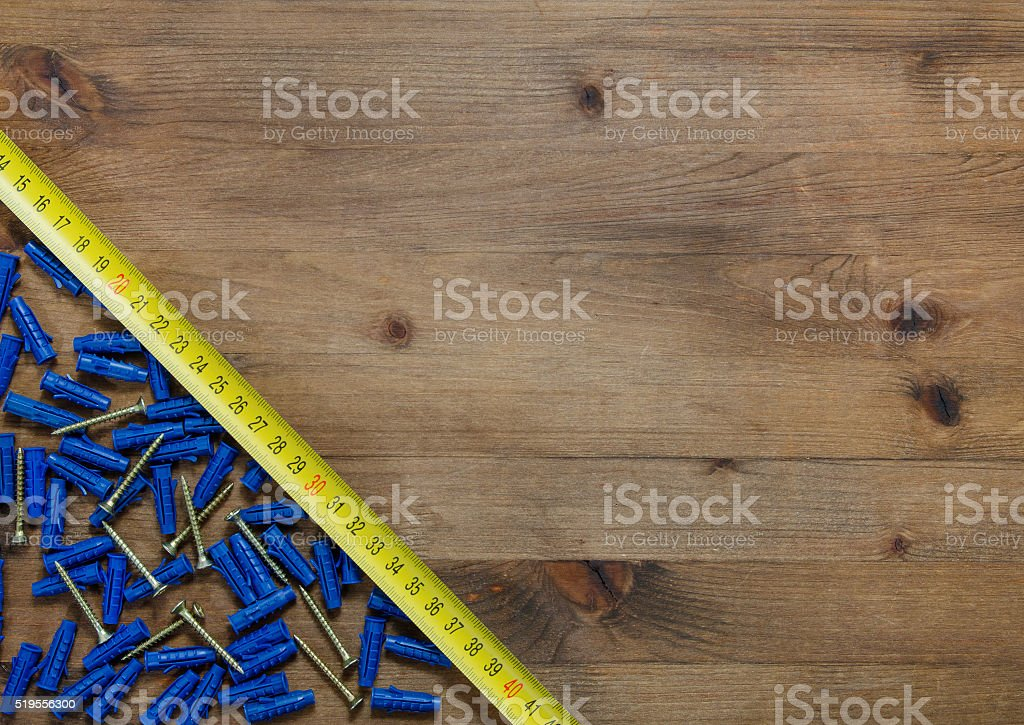 screws with blue dowels tape measure stock photo