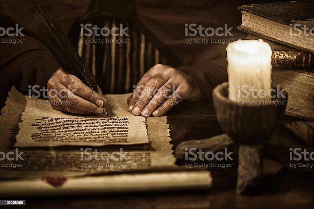 Scribe writing stock photo