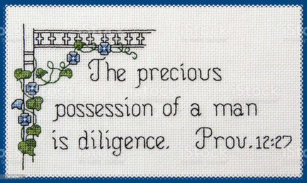 Scripture: Counted Cross Stitch on Diligence royalty-free stock photo