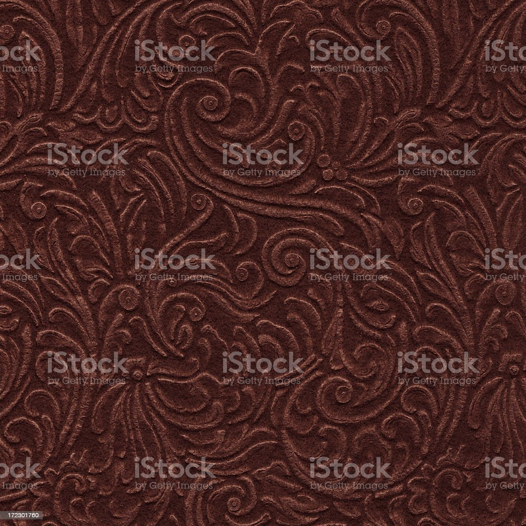 scroll engraved on vintage leather background texture stock photo
