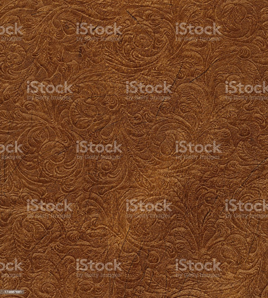 scroll engraved on vintage leather stock photo