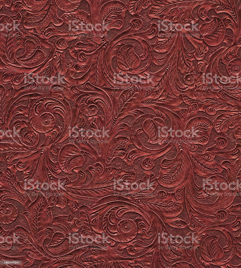 High resolution scroll engraved on vintage leather stock photo