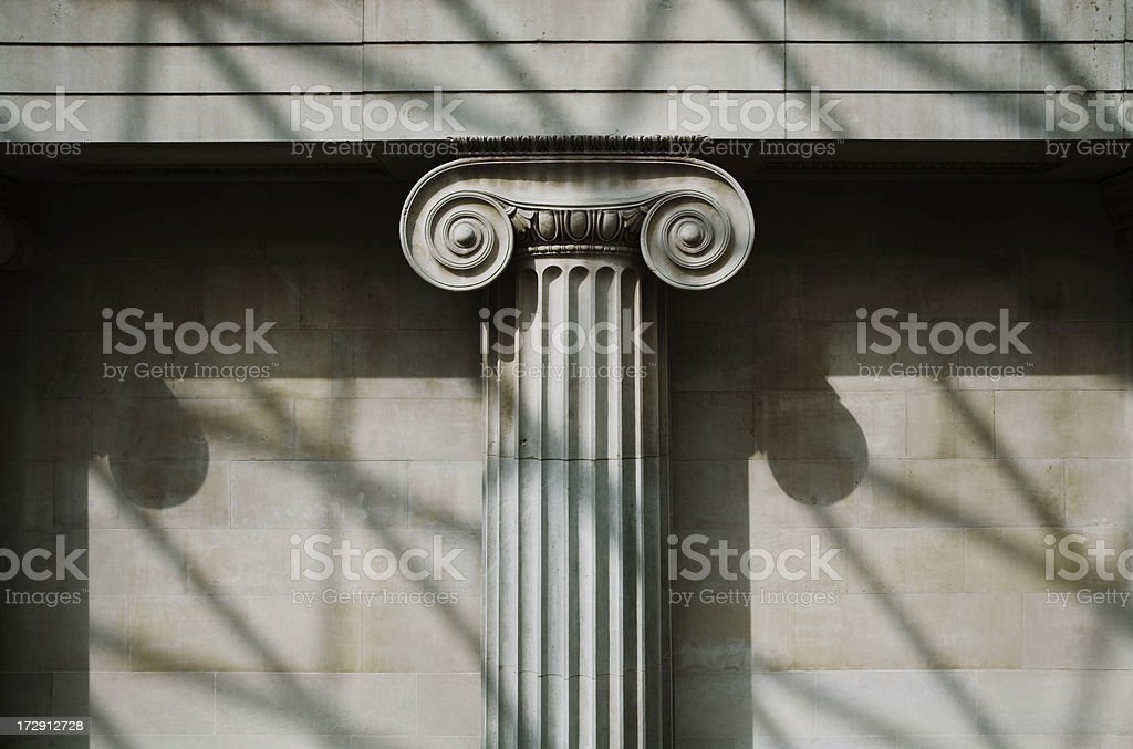 Scrolled Stone Column stock photo