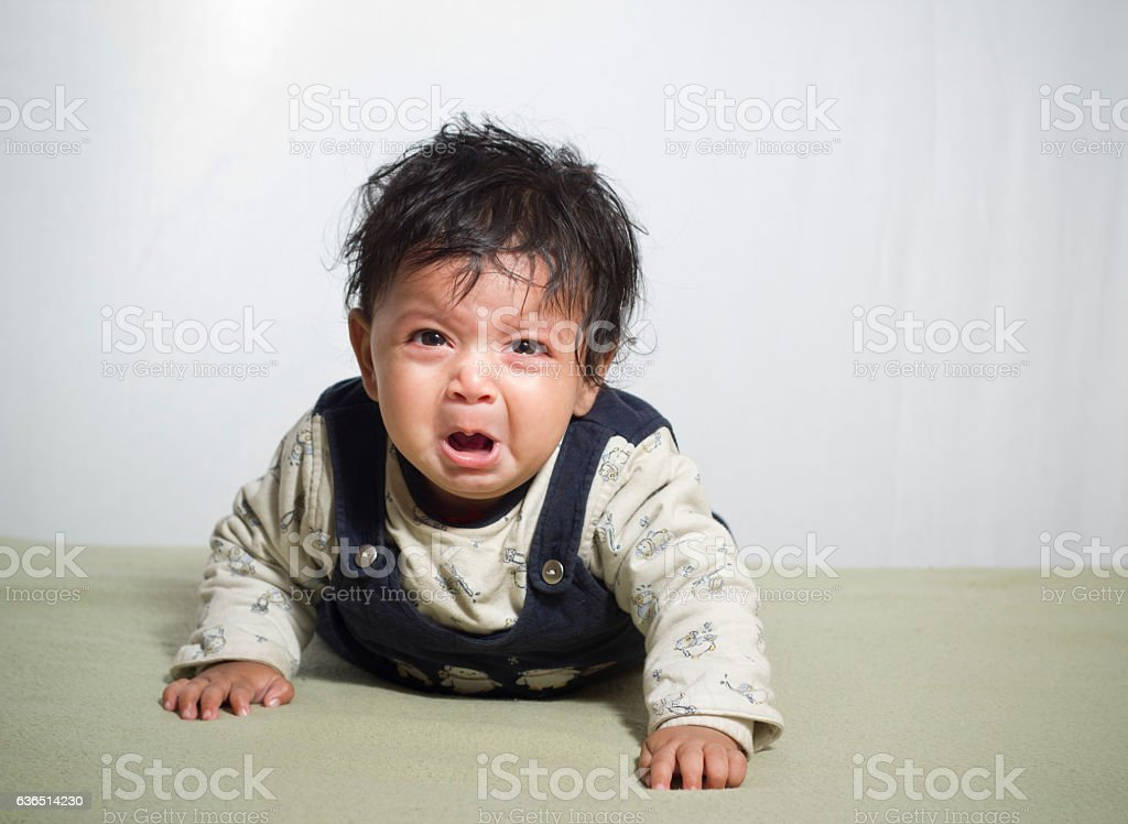 Scrolling and Crying baby girl stock photo
