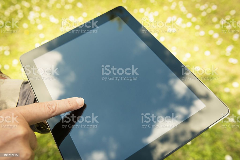 Scrolling on a digital tablet royalty-free stock photo