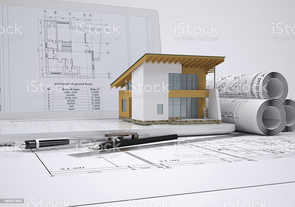 Scrolls architectural drawings and small house stock photo