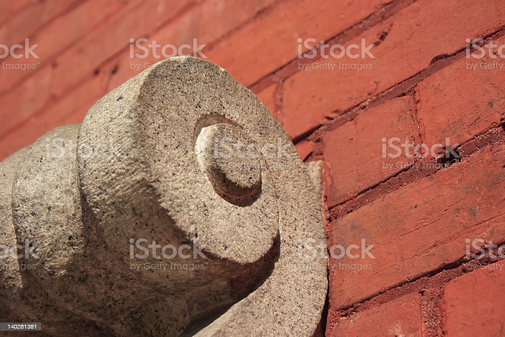 Scrollwork on brick wall royalty-free stock photo