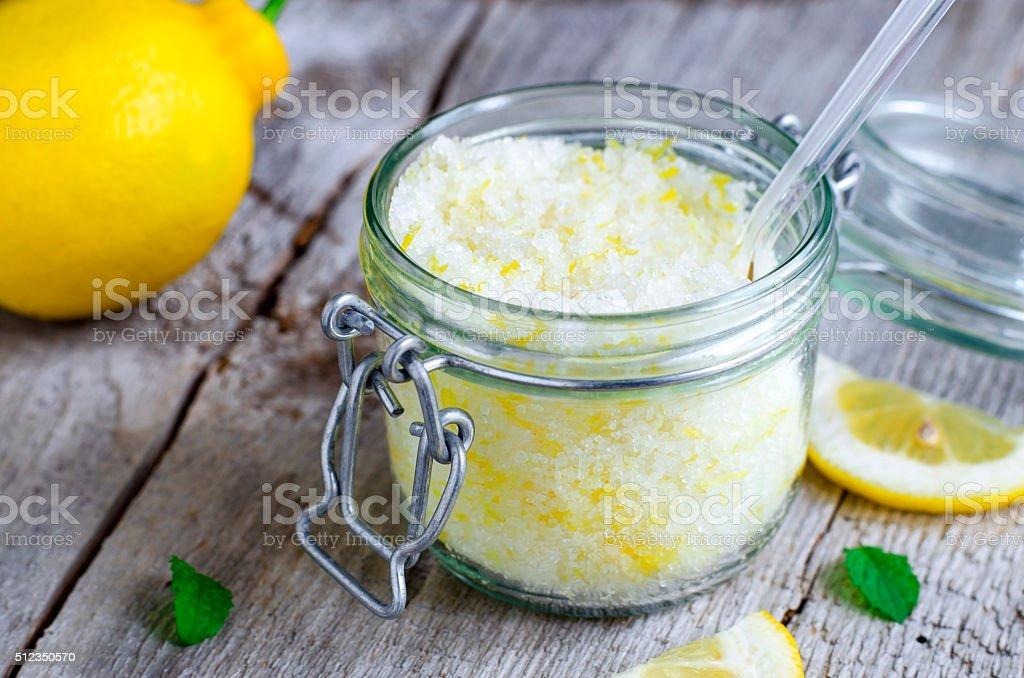 Scrub made of sea salt, lemon peel and lemon juice stock photo