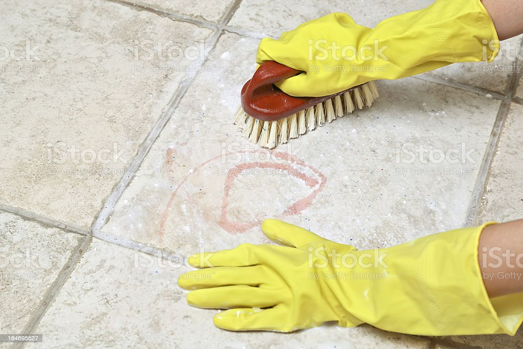 scrubbing the tiles royalty-free stock photo