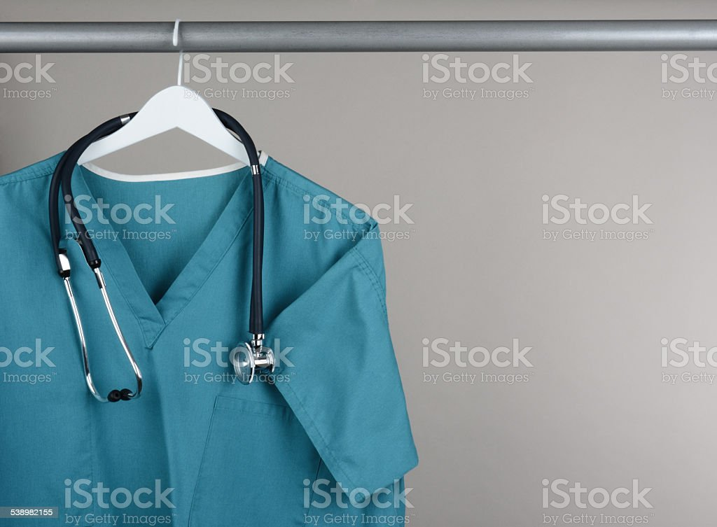 Scrubs with Stethoscope on Hanger Horizontal stock photo