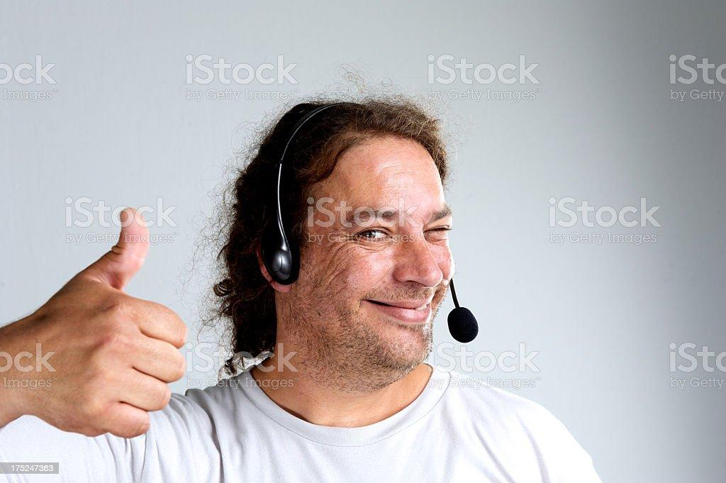 Scruffy call centre guy stock photo