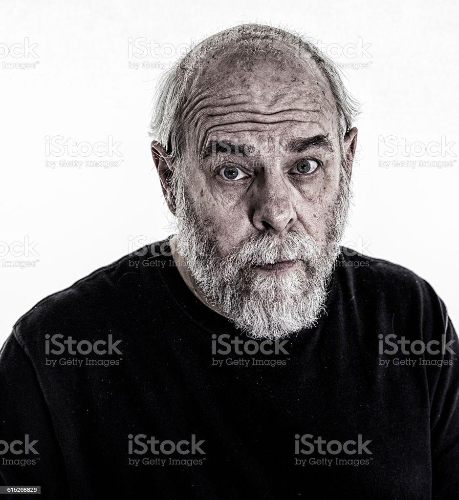 Scruffy Senior Man Carlin Quizzical Facial Expression stock photo