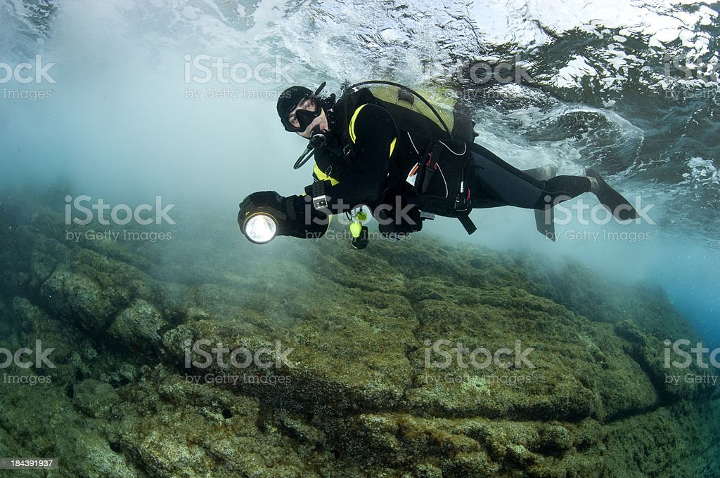 Scuba diver below the surface stock photo