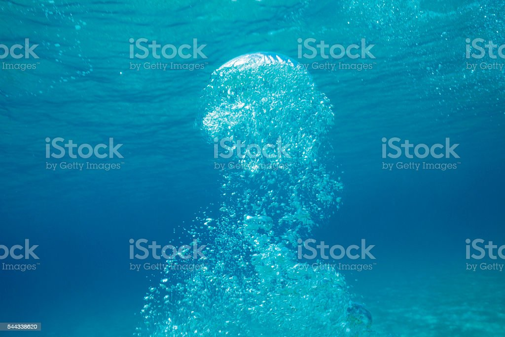 Scuba diver exhalation air bubbles    Beautiful blue lagoon  Underwater  background stock photo
