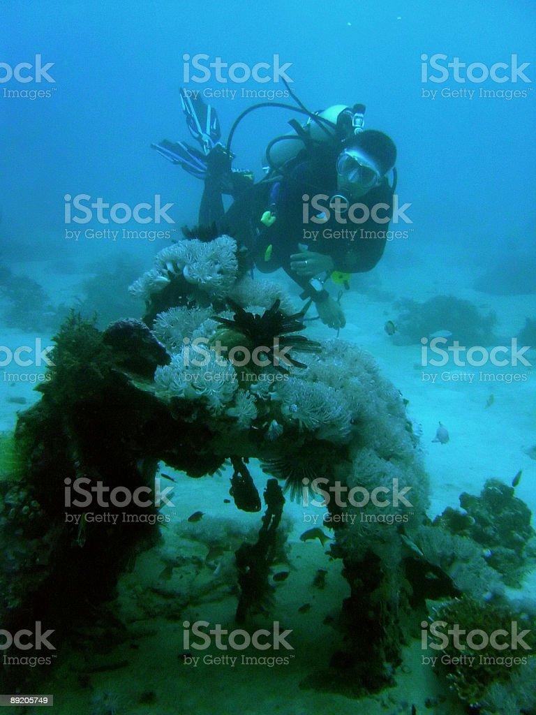 scuba diver exploring zero wreckage royalty-free stock photo