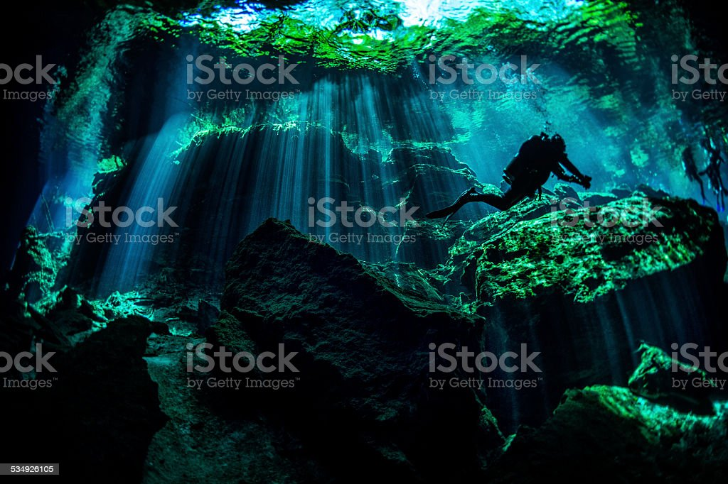 Scuba diver in underwater caves stock photo