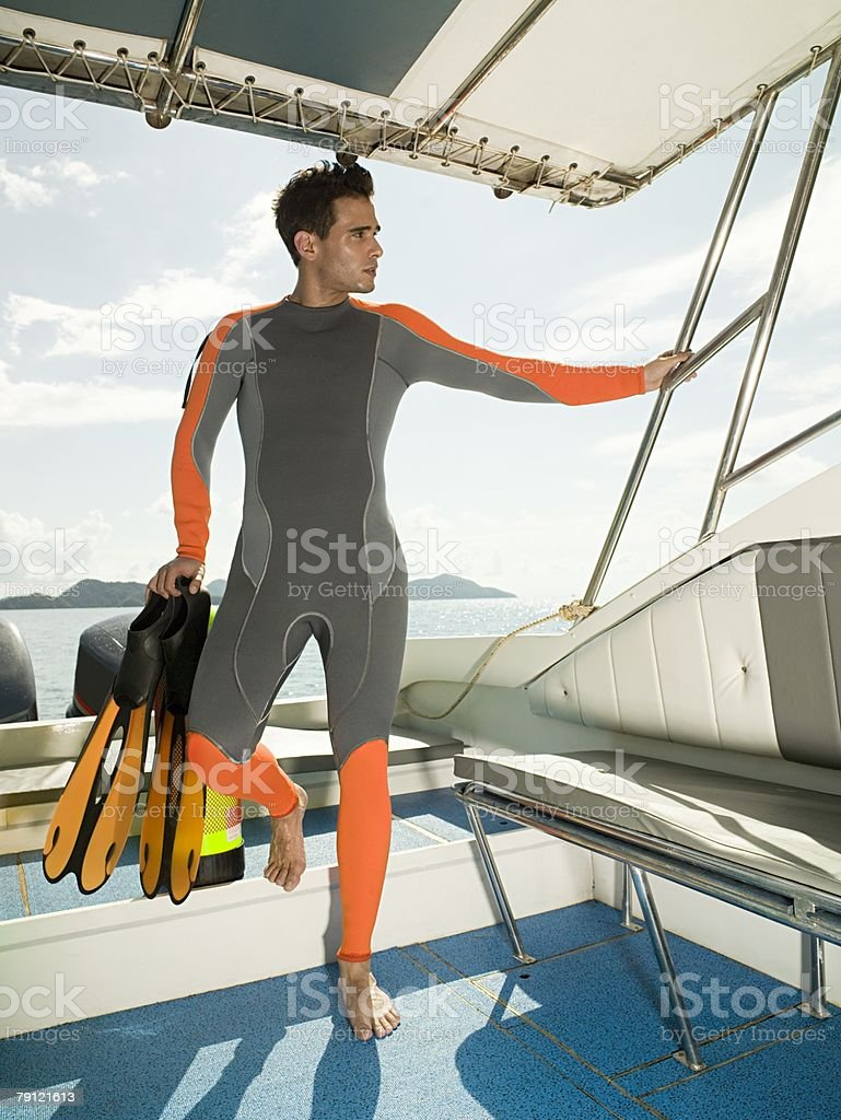 Scuba diver on a boat royalty-free stock photo