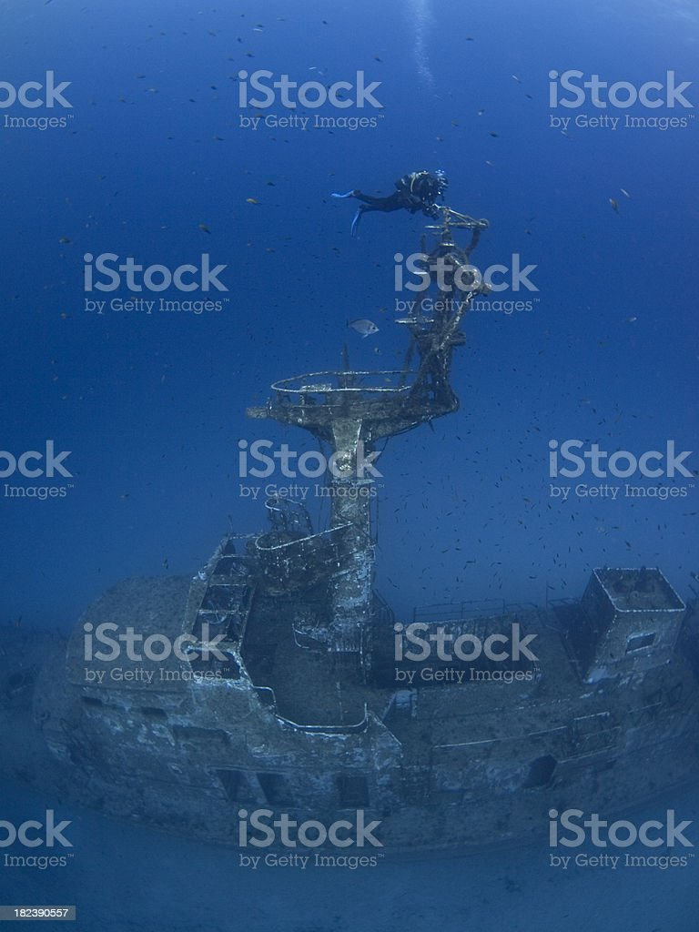 scuba diver on a shipwreck royalty-free stock photo