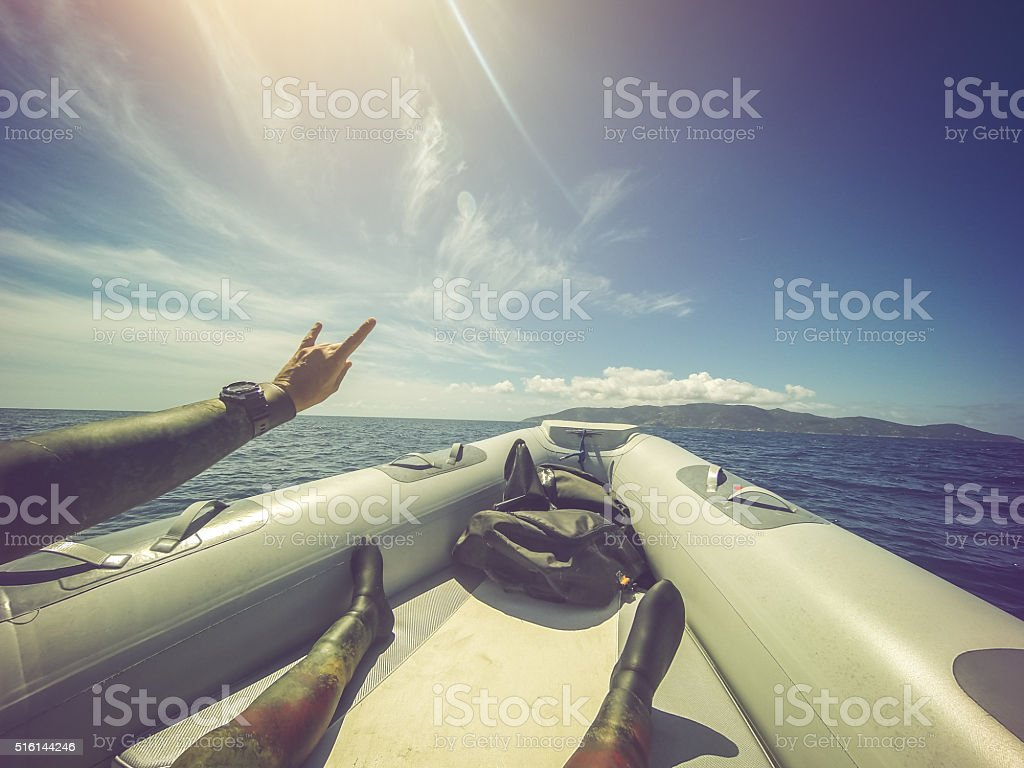 Scuba diver POV on inflatable Boat at sea stock photo