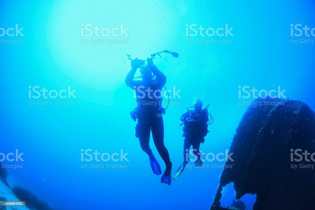 Scuba Diver Silhouette over a shipwreck stock photo