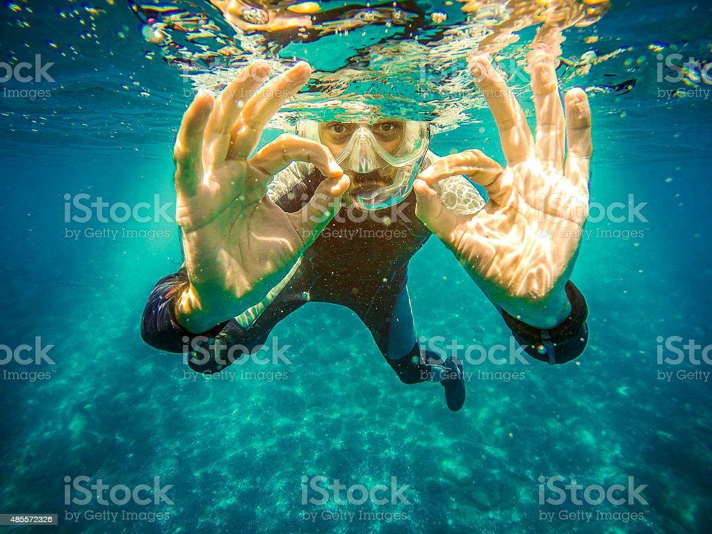 Scuba diver underwater. stock photo