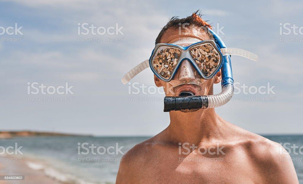 scuba diver with funny swimming goggles stock photo