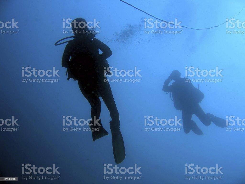 scuba divers descent stock photo