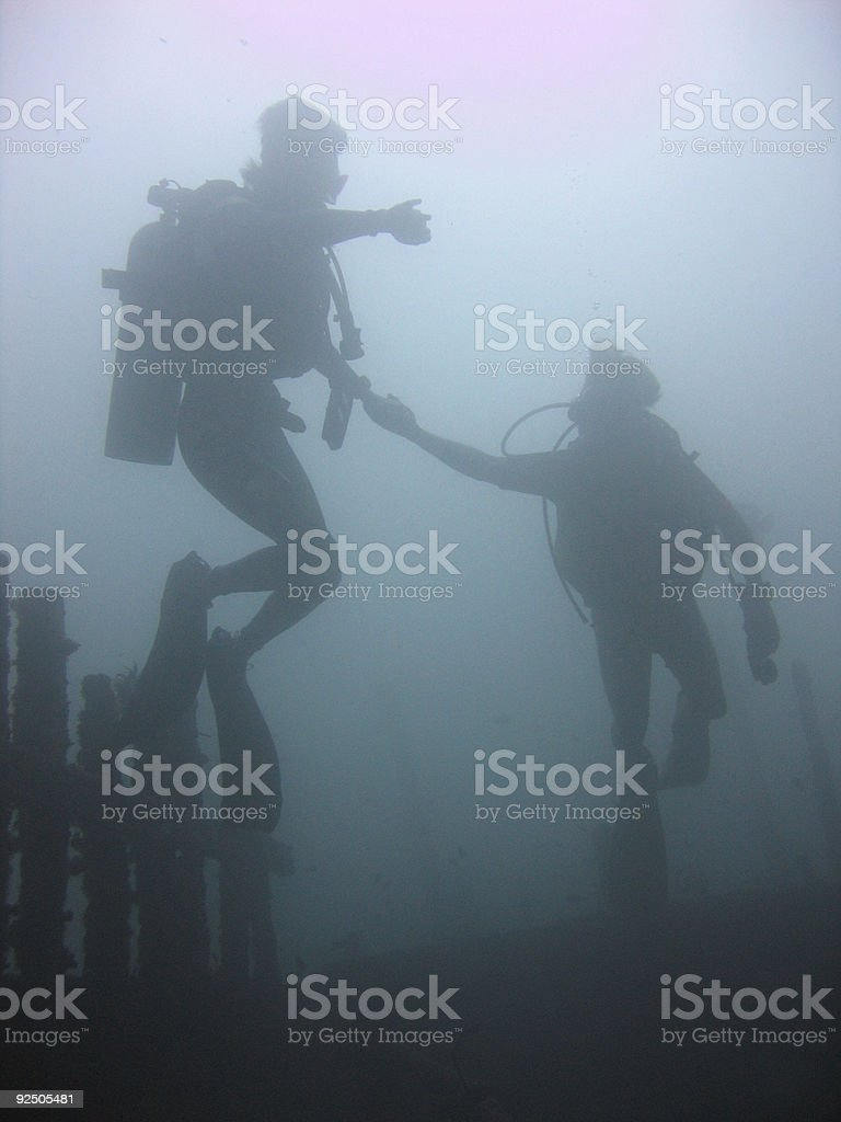 scuba divers diving sabang wrecks puerta galera royalty-free stock photo