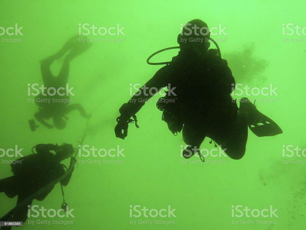 scuba divers on tank landing craft wreck royalty-free stock photo