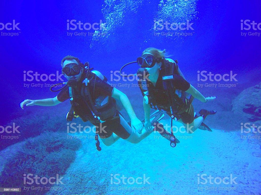 Scuba divers stock photo