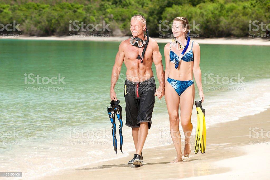 Scuba Diving: Couple Walking on Beach stock photo