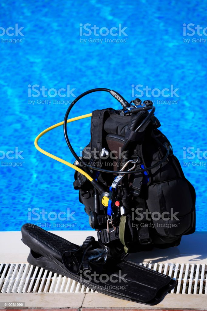 Scuba diving equipment on a Swimming Pool stock photo