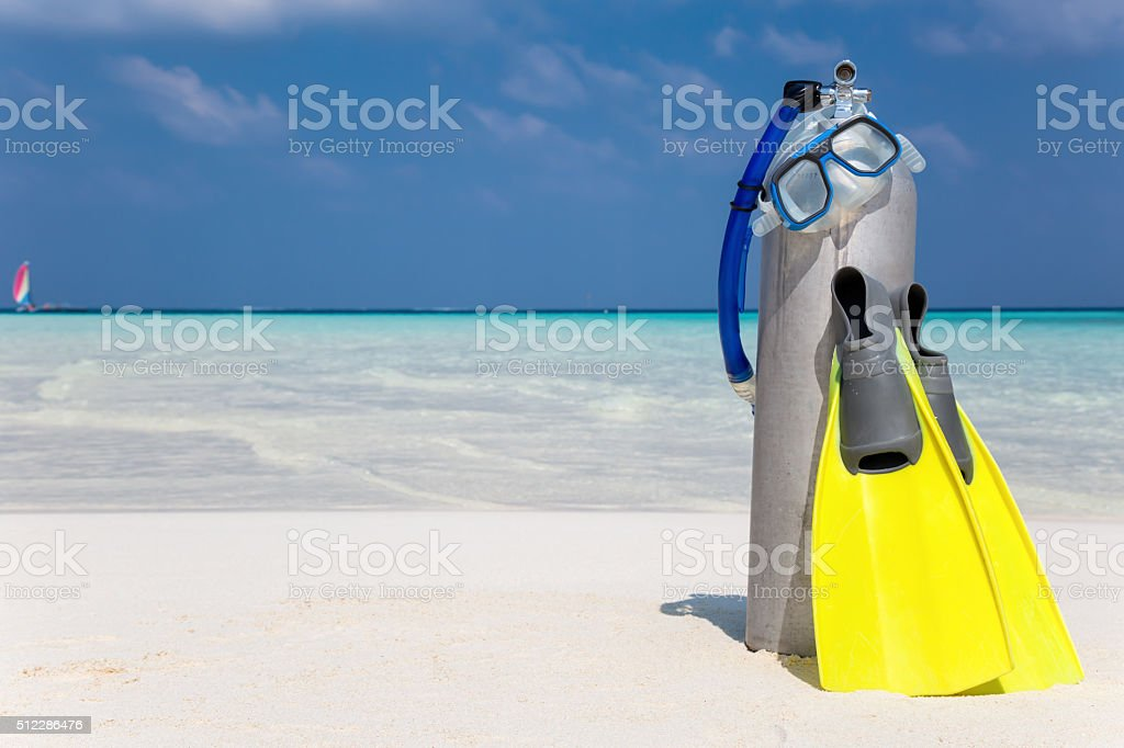 Scuba diving gear on beach stock photo