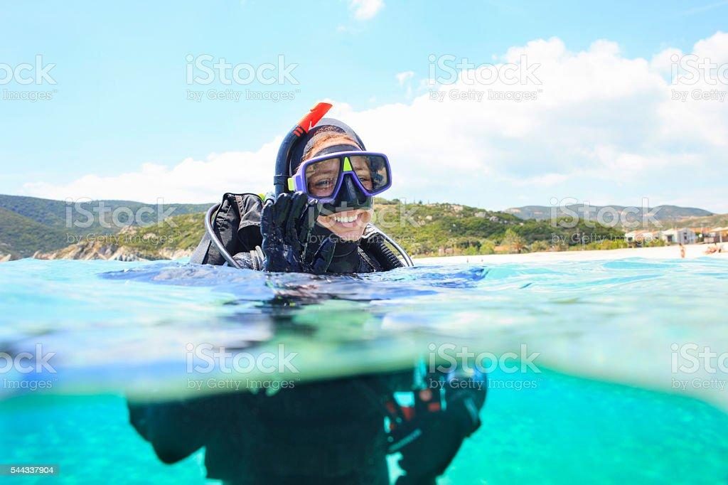 Scuba diving    Scuba diver in blue lagoon stock photo