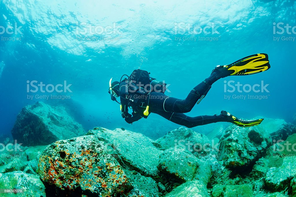 Scuba diving    Underwater  scuba diver in blue lagoon stock photo