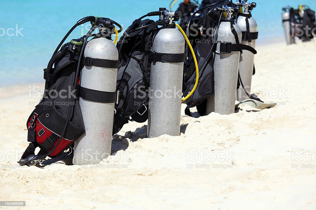 Scuba tanks on the beach royalty-free stock photo